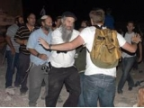 Israeli settlers prevent a Christian service in Beit Sahour, assault worshippers